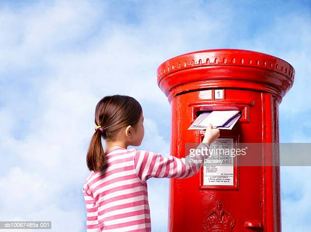 girl (6-7) posting letter - sending stock photos and pictures