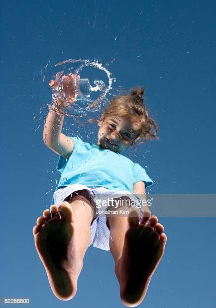 Girl pours out water from l