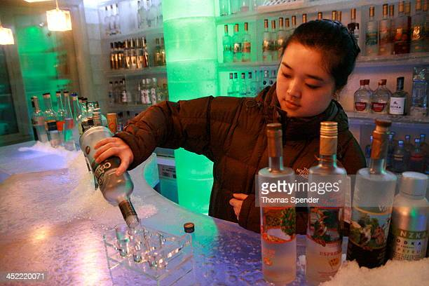 CONTENT] Girl pours vodka in an ice bar Shanghai