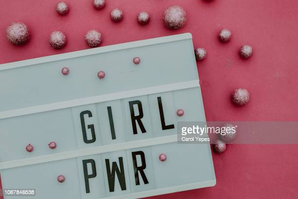 girl power message in lightbox.top view - women's rights stock pictures, royalty-free photos & images