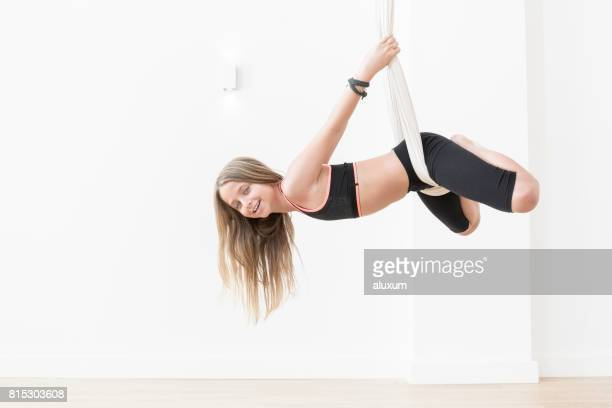 Girl practicing aerial yoga