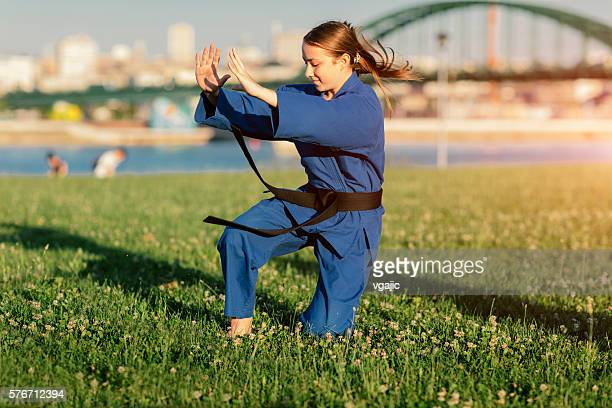 Girl Practicing Aikido Outdoors.