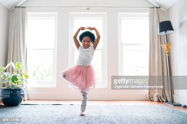 Girl practicing ballet dance at home