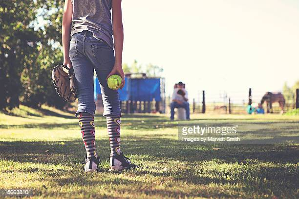 girl practicing fastpitch softball with catcher - baseball mom stock pictures, royalty-free photos & images