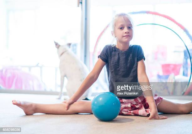 Girl practicing gymnastics at home