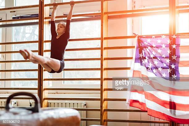 GIrl Practicing Gymnastics in School Gym.