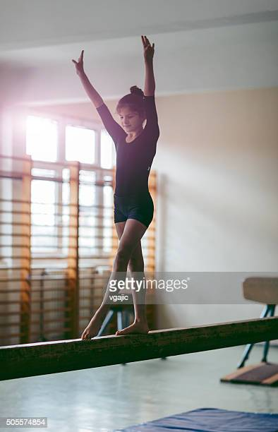 GIrl Practicing Gymnastics.