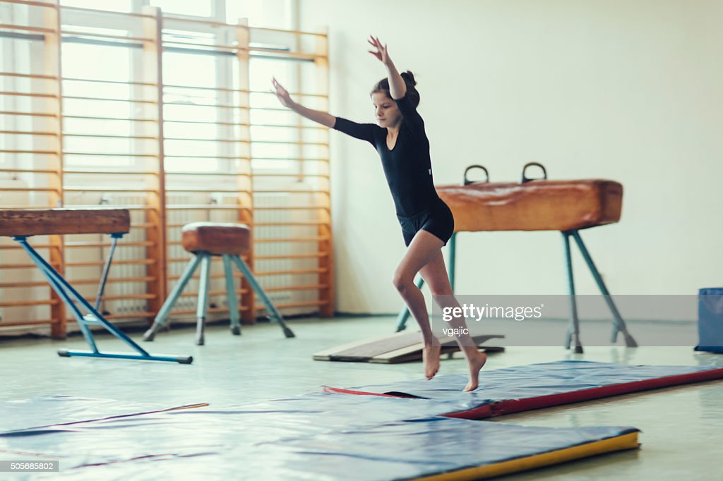 GIrl Practicing Gymnastics. : Stock Photo