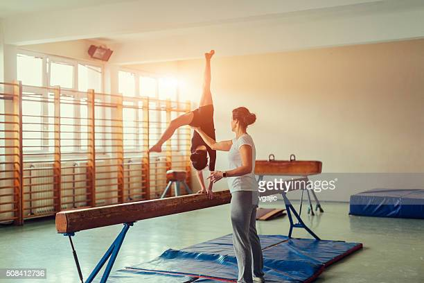 girl practicing gymnastics - gymnastics stock pictures, royalty-free photos & images