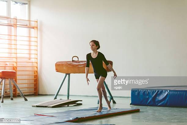 girl practicing gymnastics. - school gymnastics stock photos and pictures