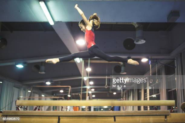 girl practicing gymnastics - balance beam stock pictures, royalty-free photos & images