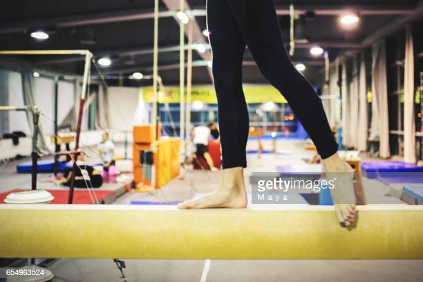 girl practicing gymnastics - school gymnastics stock photos and pictures
