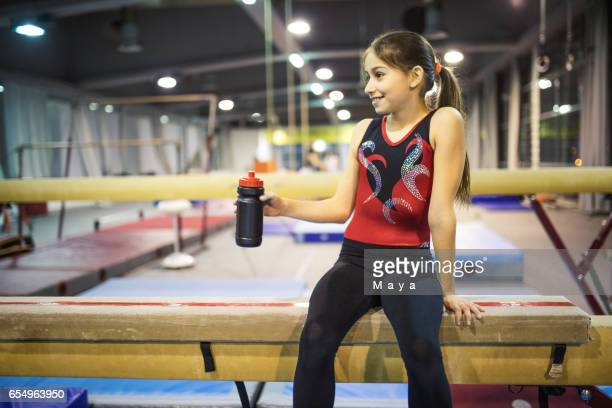 girl practicing gymnastics - little girls doing gymnastics stock photos and pictures