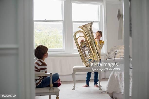 Girl practicing the tuba