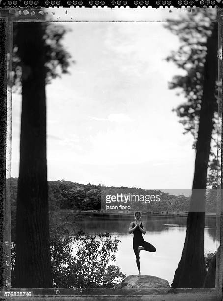 A girl practicing yoga in a natural setting Photographed in black and white on Polaroid film