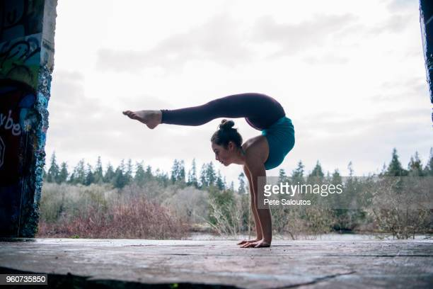 girl practising yoga on outdoor stage - flexibility stock pictures, royalty-free photos & images
