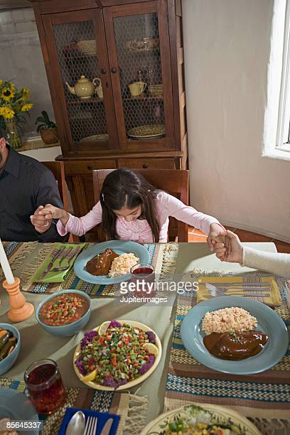 girl praying at dining table - mole sauce stock pictures, royalty-free photos & images