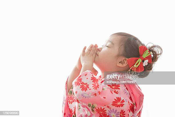 Girl Praying During Shichi-Go-San Festival