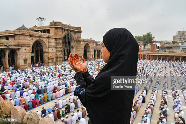 Girl prays on the day of Eid Eid alFitr is the end of Ramazan and the first day of the month of Shawwal for all Muslims in Jama Masjid Ahmedabad