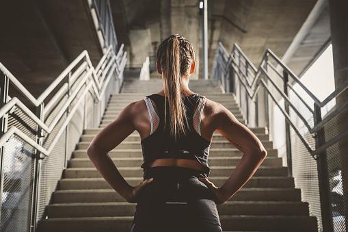 Girl prepairing for workout 615919228