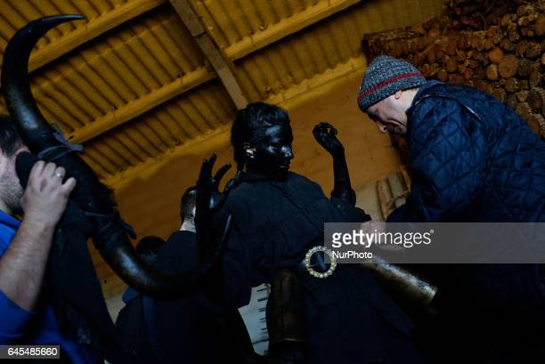 A girl prepares herself for Luzon's Carnival during an ancient Carnival in Guadalajara Spain on 25 February 2017 The Devils of Luzón that carry...
