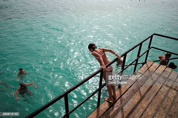 A girl prepares to jump in the water at a resort on the Red Sea on November 5 2015 in Sharm ElSheikh Egypt British flights going to and from Egyptian...