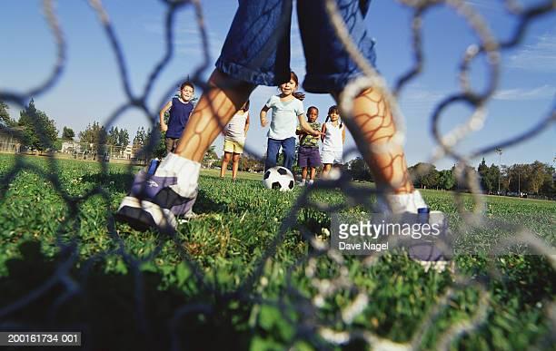 girl (4-6) preparing for penalty kick, ground view - calcio di punizione foto e immagini stock