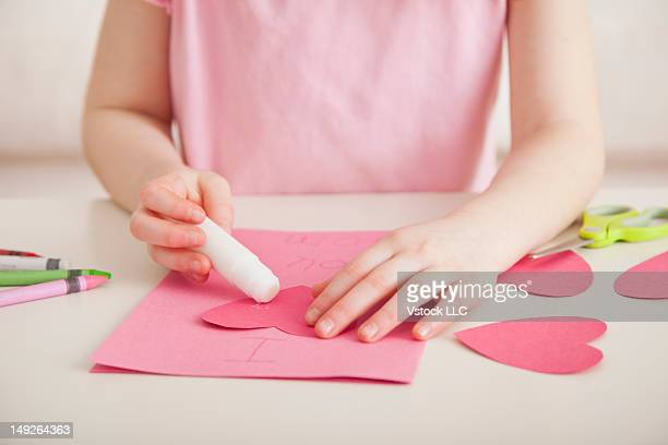 Girl (4-5) preparing greeting card