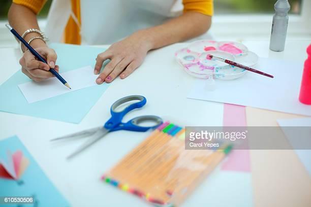 girl preparing greeting cards