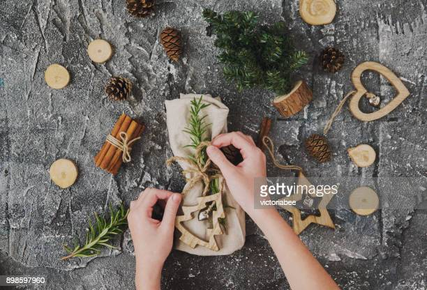 Girl preparing napkin with Christmas decorations