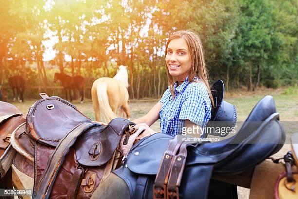 Girl preparing the raddles for horses