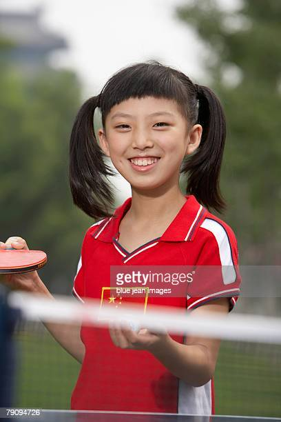A girl preparing to serve.