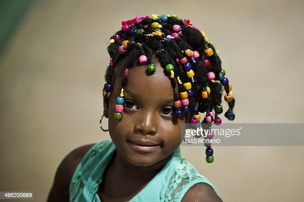 A girl presents an AfroColombian hairstyle during the 10th contest of Afrohairdressers Tejiendo Esperanzas on June 1 in Cali Valle del Cauca...