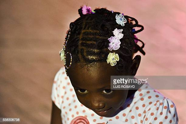 A girl presents an AfroColombian hairstyle during the 12th contest of Afro hairdressers Tejiendo Esperanzas in Cali Valle del Cauca department...