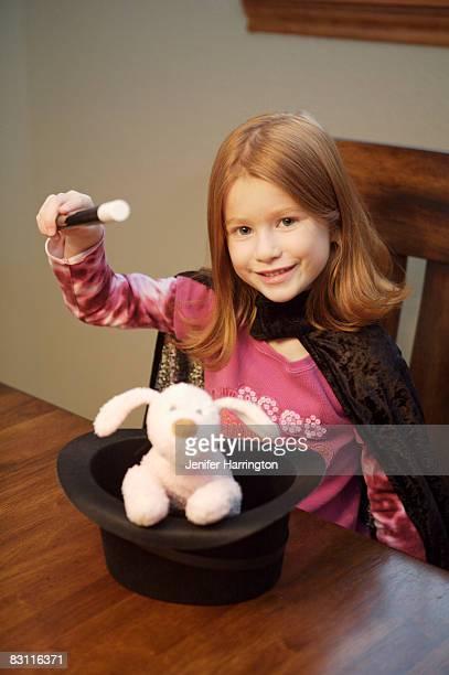Girl pretending to be magician