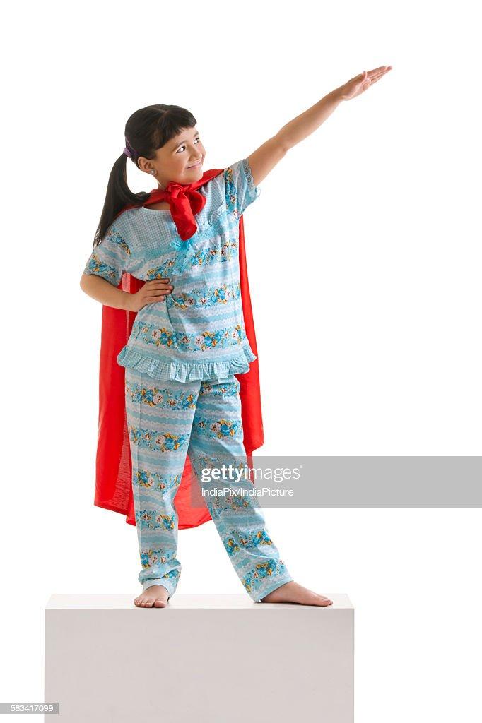 Girl pretending to be superman : Stock Photo