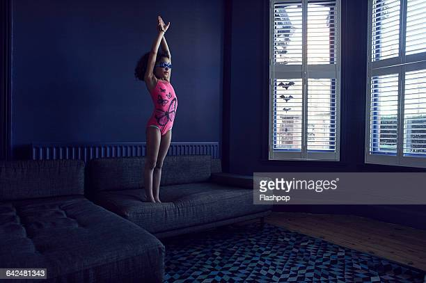 girl pretending to dive - navy blue stock pictures, royalty-free photos & images