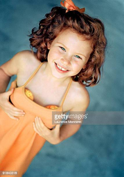 girl pretending to have breasts - young girl breasts stock pictures, royalty-free photos & images