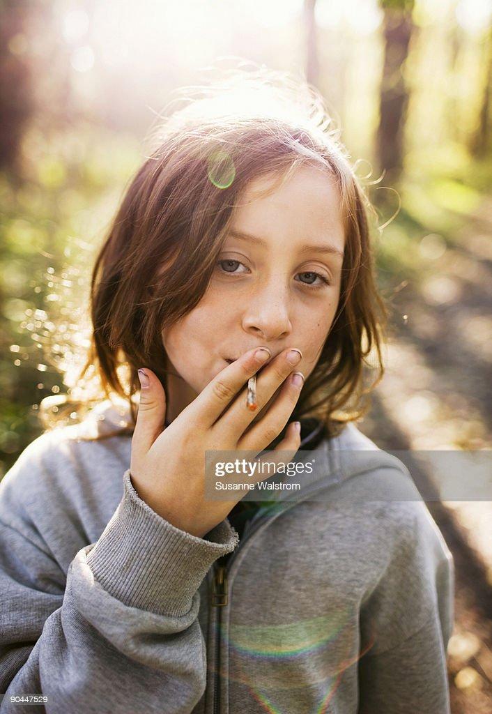 A girl pretending to smoke Sweden. : Stock Photo
