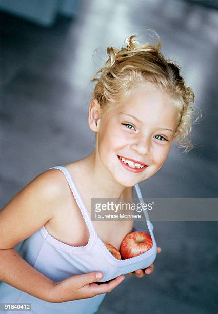 girl pretending with apples as breasts - chest barechested bare chested stock pictures, royalty-free photos & images