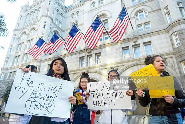 Girl protest Donald Trump outside of the Trump International Hotel on Pennsylvania Avenue on November 11, 2016 in Washington, DC.