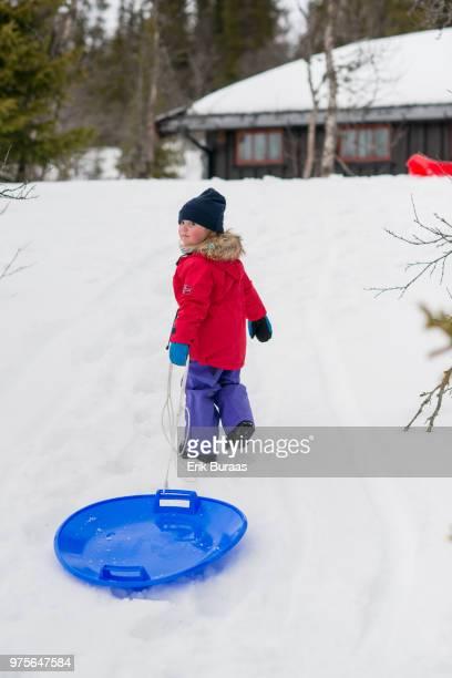 Girl pulling a sledge