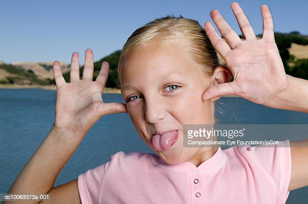 girl (10-11 years) pulling funny face, portrait, close up - 10 11 years stock pictures, royalty-free photos & images