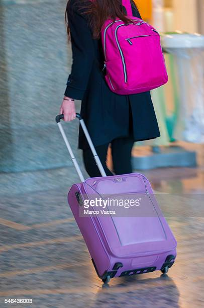 Girl pulls her colorful trolley