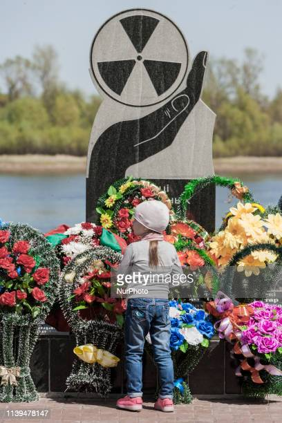 A girl puts a wreath in the Chernobyl memorial in Naroulia Belarus during the celebrations of the 33 anniversary of the catastrophe In 1986 the city...