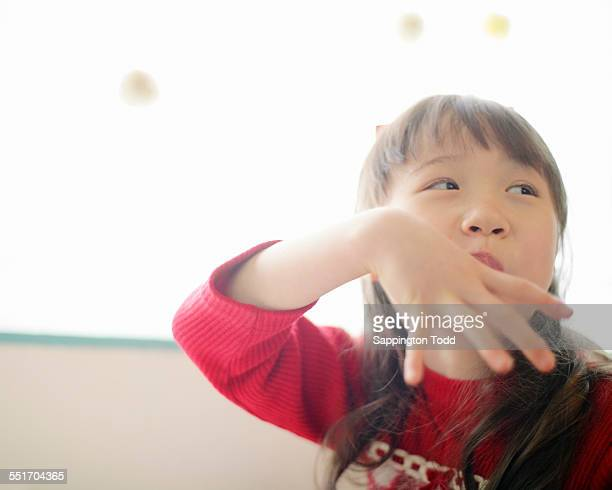 Girl Putting Her Finger In Mouth