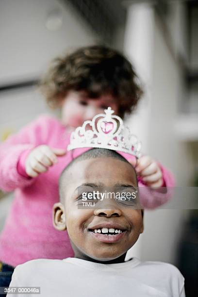 Girl Putting Tiara on Boy