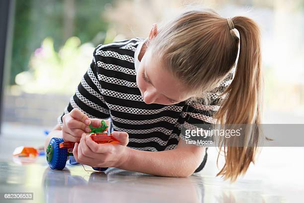 girl putting together robot