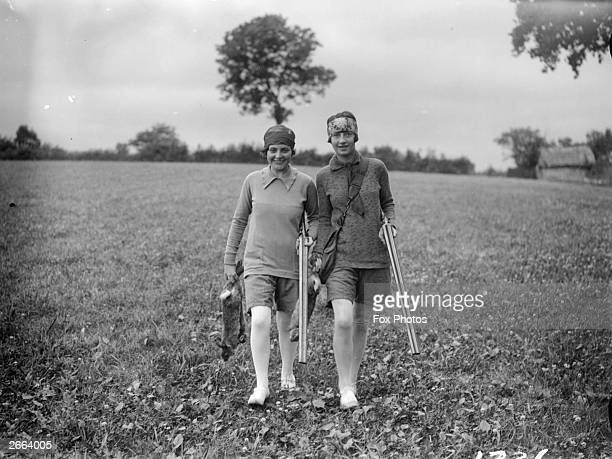 Girl rabbit shooters with their prey in a Devon field