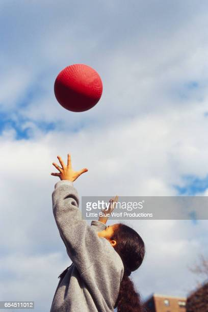 Girl Reaching for Ball